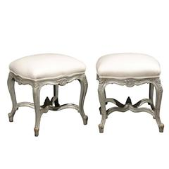 Pair of French Louis XV Style Silver Leaf Stools with Carved Cross Stretcher
