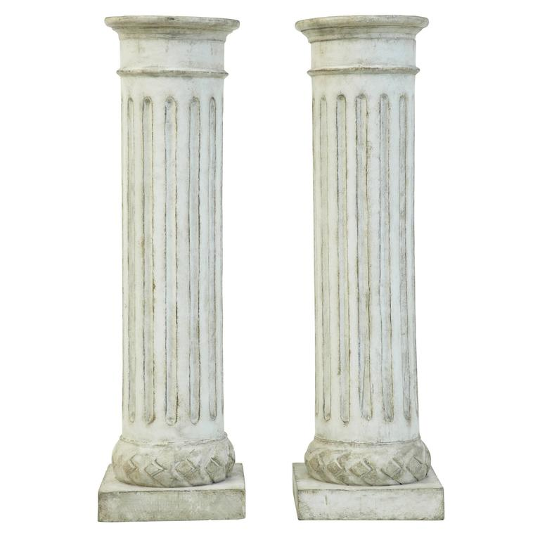 Pair of faux stone carved wooden columns at stdibs
