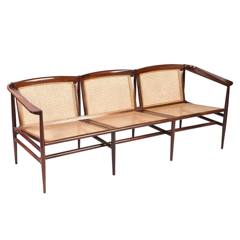Brazilian Modern Rosewood and Cane Sofa by Joaquim Tenreiro