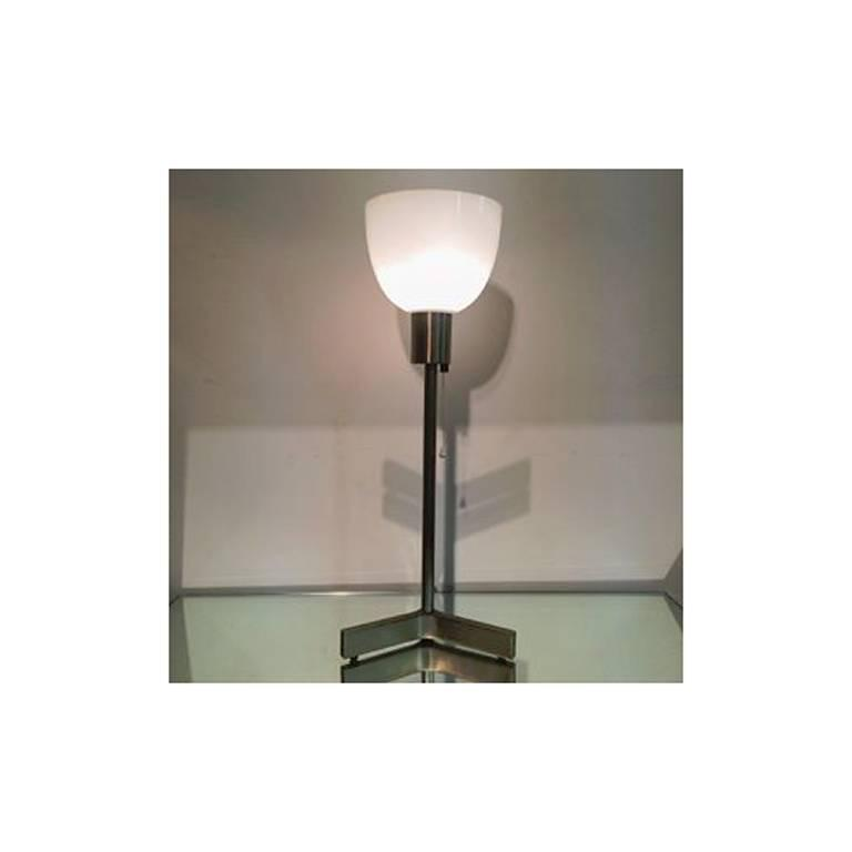 Chic French design is an early example of mod minimalism. Solid bronze base and stem with mirror gun metal patina. Employs pull chain and upright glass diffuser. Very high quality construction.