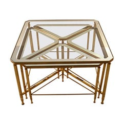 Five piece nesting tables brass frames with mirrored tops