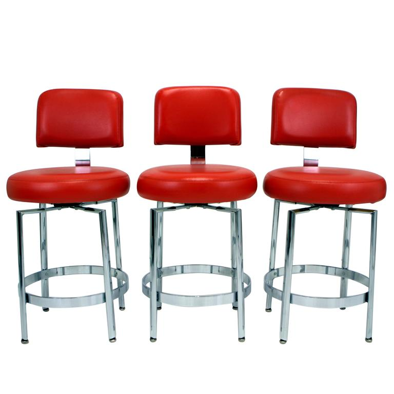 Set Of Three Modernist Chrome Counter Height Swivel Stools
