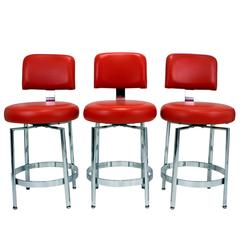 Set of Three Modernist Chrome Counter Height Swivel Stools by Tri-Mark Tulip