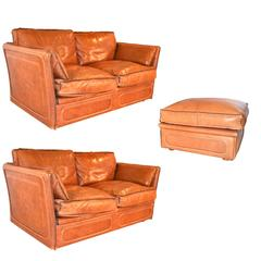 Pair of Leather Sofas and Ottoman