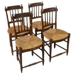 Set of Four 19th Century French Directoire Style Carved Walnut Rush Seat Chairs