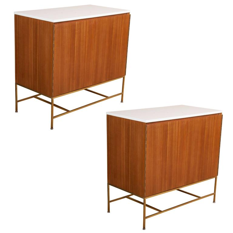 A Pair of Paul McCobb Cabinets with Vitrolite Glass Tops And Brass Stretchers