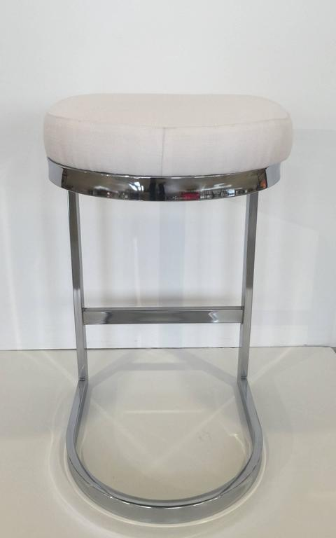 Chrome bar stool with upholstered seat by Design Institute of America. USA, circa 1970. Priced individually. Includes new re-upholstery in Sunbrella off white, linen-look fabric. Also available in COM/COL; one yard of fabric per stool and two week
