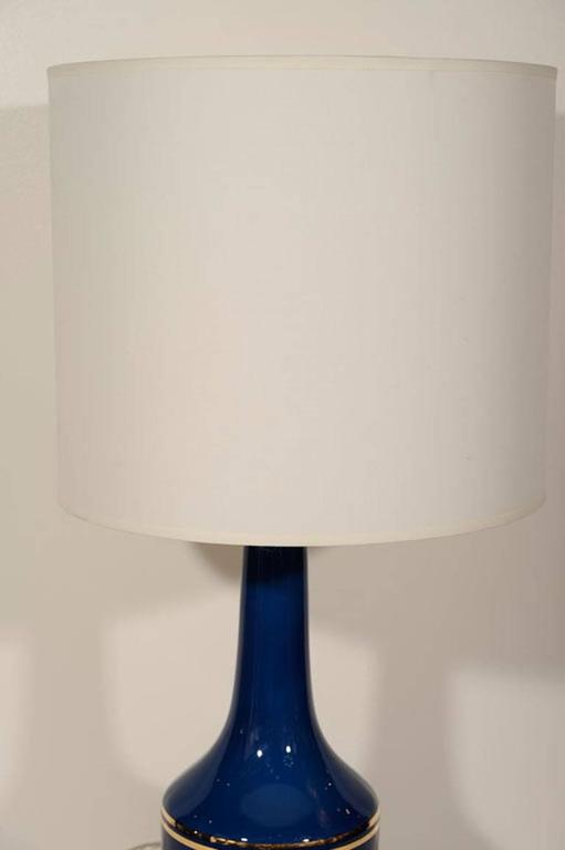 Pair of cobalt blue glass lamps with parallel 22-karat gold stripes by Lyktan Haus for Holmegaard.