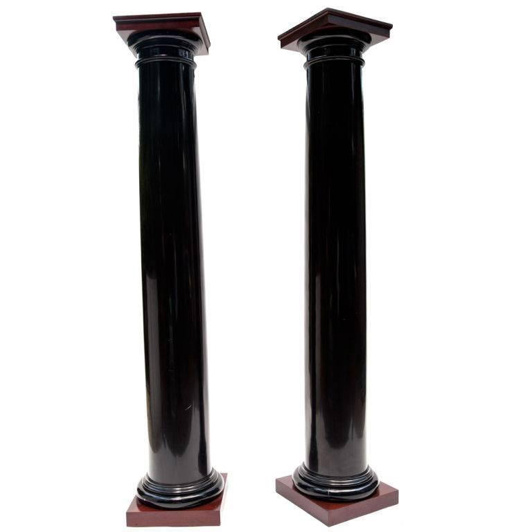 Black lacquer wood columns with mahogany caps and bases