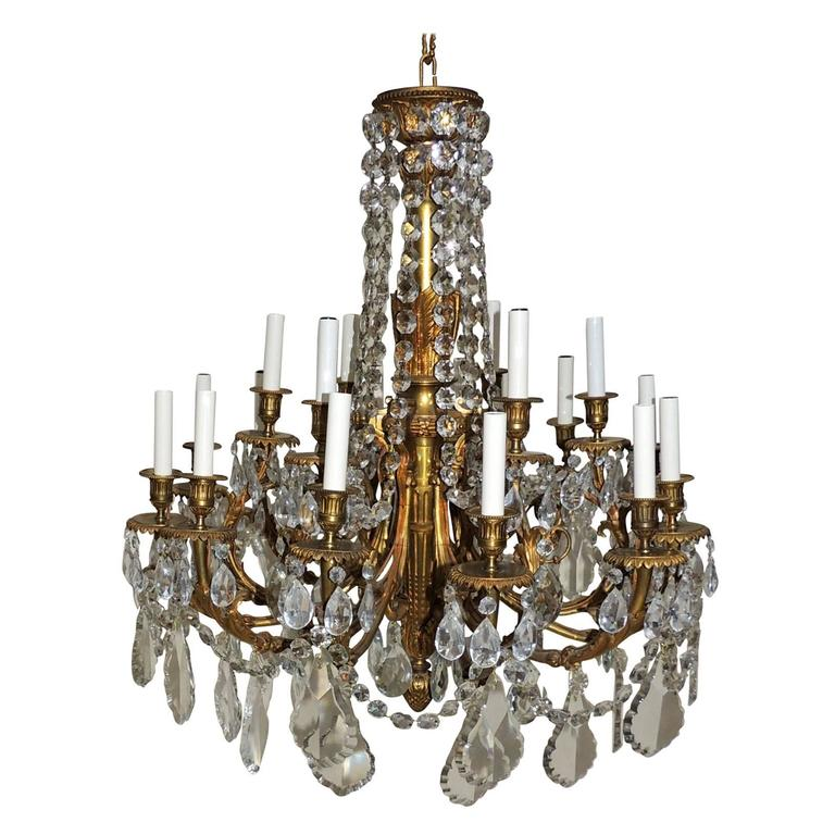 Beautiful French Empire Doré Bronze & Draped Crystal Eighteen-Light Chandelier For Sale