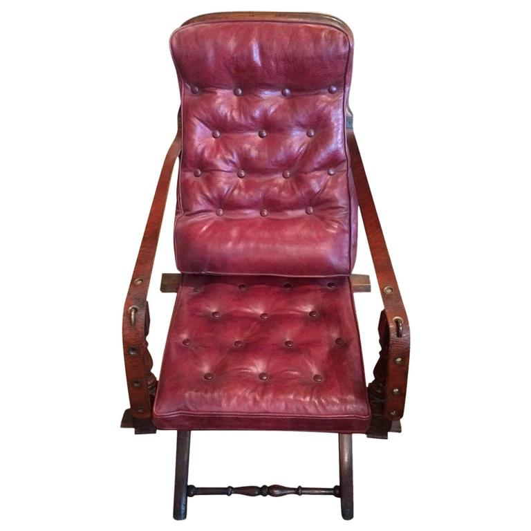 Red Leather Campaign Chair