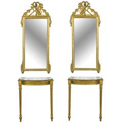Tall Pair of Louis XVI Giltwood Mirrors and Consoles with White Marble