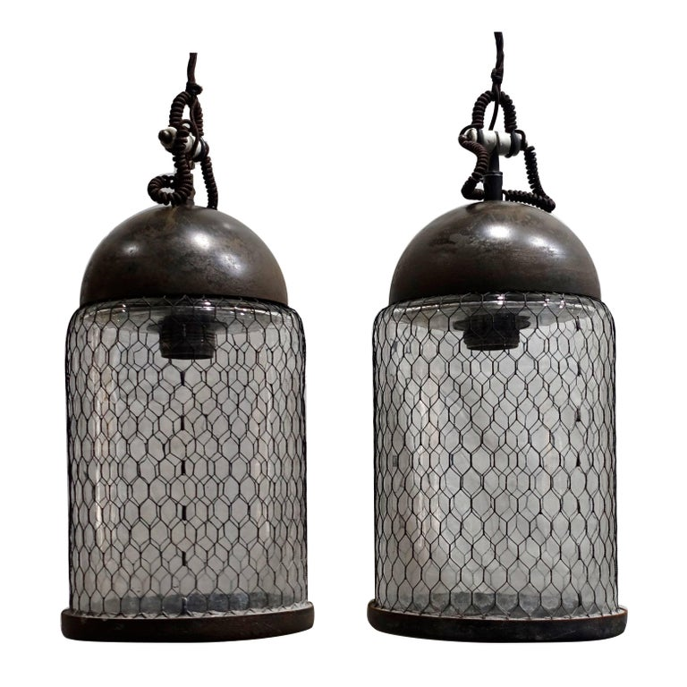 Contemporary Pair of Brushed Metal Pendant Lights with Cage, Italy For Sale