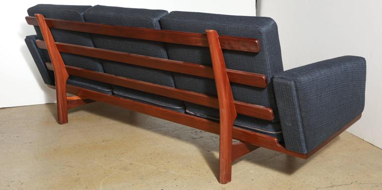 Scandinavian Modern Hans Wegner for GETAMA GE-236 Solid African Teak Three-Seat Sofa, circa 1955 For Sale