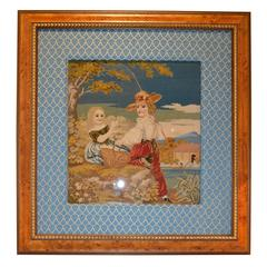 Framed Needlepoint of a Boy and Girl on a Picnic