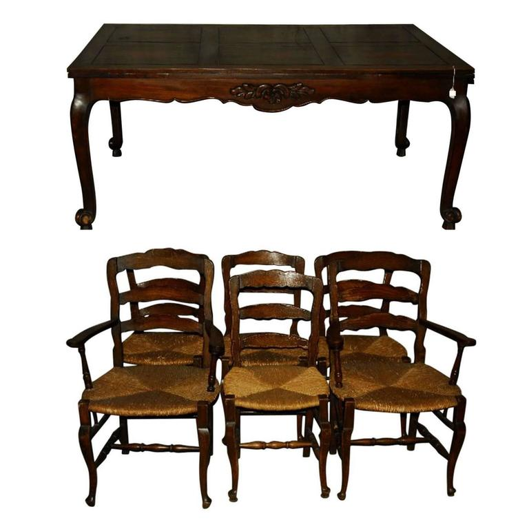 Th century french country carved oak dining table and
