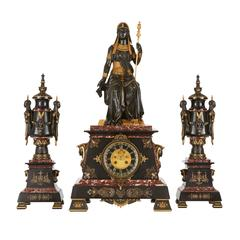 Egyptian Revival Marble, Gilt and Patinated Bronze Three-Piece Clock Set