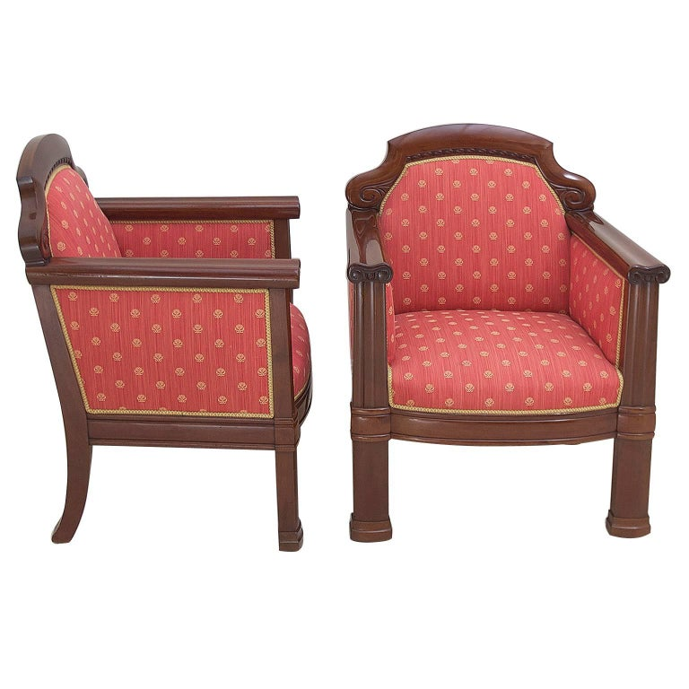 A stunning pair of very comfortable Danish Art Deco armchairs with fluted pillars capped with ionic capitals on the arm fronts, and arched and carved crest rail. Frames are made of very fine solid, West Indies/ Cuban mahogany & have been