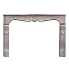 19th Century French Louis XV Style Limestone Fireplace