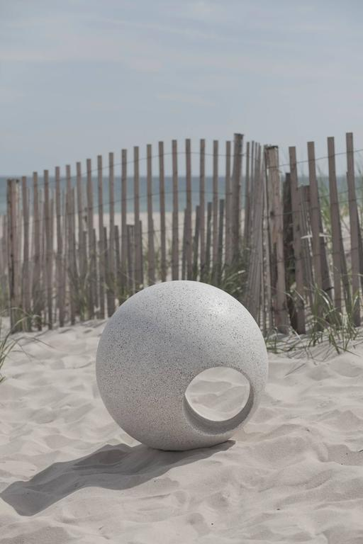 Outdoor Sphere is cast in fiberglass with stone aggregate to a look and feel like concrete or stone. This unique design is a beautiful addition to an outdoor space as a decorative sculpture or abstract seat.   Item: Outdoor Sphere by May