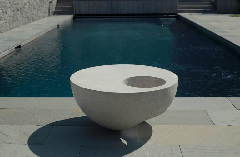 This original design sculptural coffee table is made in cast fiberglass with stone aggregate that has the look of concrete. Made for indoor or outdoor use.  Shown here in Natural Fiberglass Dimensions: 36