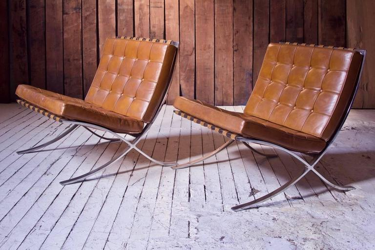 """All original vintage condition pair of leather and stainless steel """"Barcelona"""" chairs by Mies Van Der Rohe, circa 1965. Originally designed by Van Der Rohe for the German Pavilion at the 1929 International Exposition in Barcelona, this"""