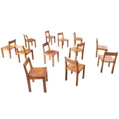 Pierre Chapo Set of 12 'S24' Dining Chairs in Elm and Patinated Cognac Leather