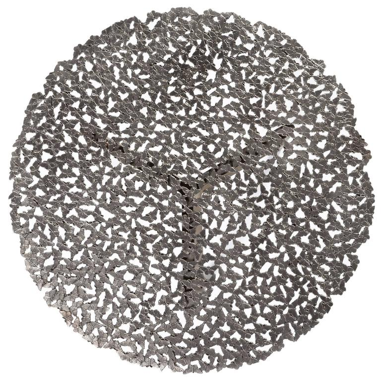 A swarm of butterflies as delicate as a lace table cloth forms an everlasting tabletop in white bronze, lost wax cast by Italian master craftsmen. A sculptural table for both indoor and outdoor use. This listing is for the white bronze version, for
