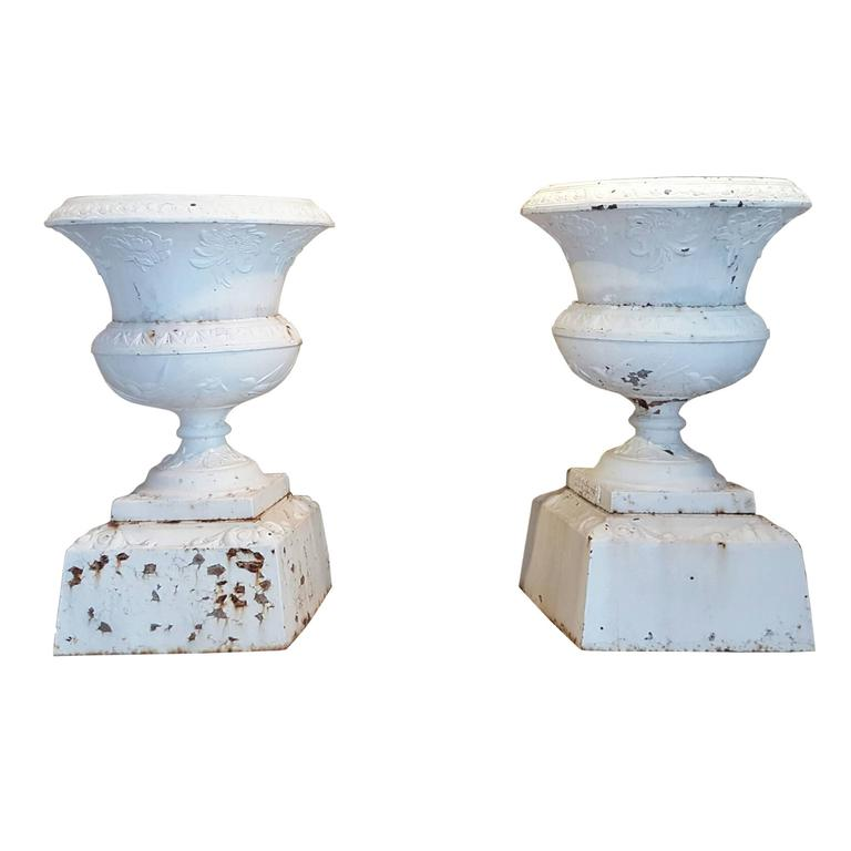 Pair of 19th Century Cast Iron Urns on Pedestal For Sale