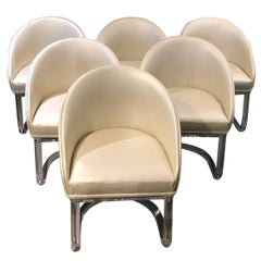 Set of six Lion in Frost Swivel Lucite Base Chairs