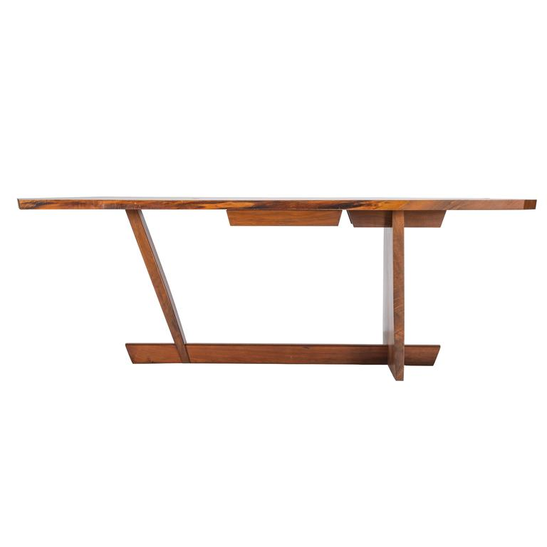A true masterwork by George Nakashima. Exceptionally scaled 7ft Conoid desk with a single drawer. Each board was specially hand picked. Each expressive grained board is exceptional and used throughout the desks construction. Desk is signed and dated