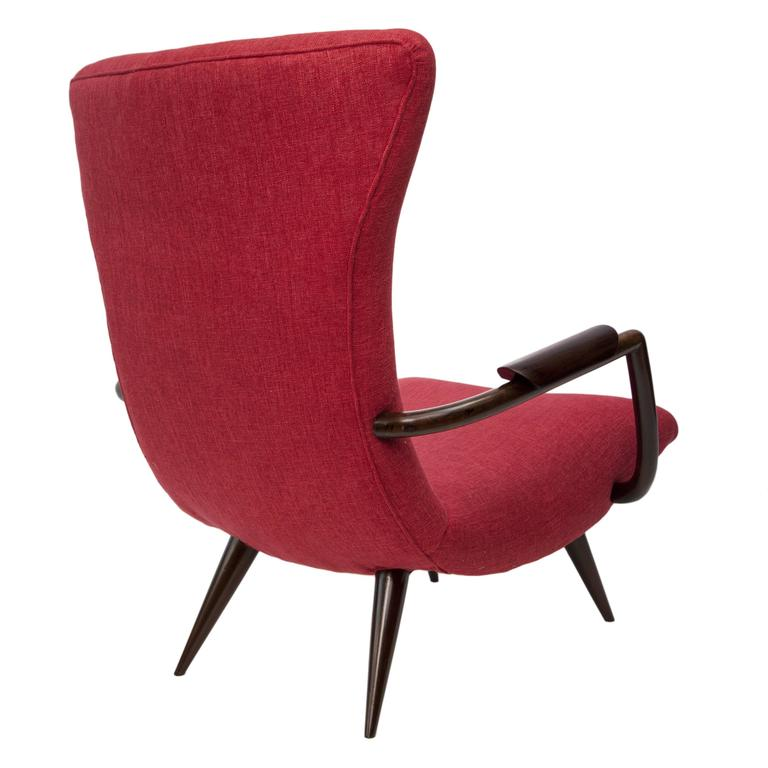A pair of 1950s Brazilian armchairs by designer Giuseppe Scapinelli, the highly modernist back and seat upholstered in red fabric, curved arms and tapered legs in rich jacarandá wood. These chairs are in excellent vintage condition, consistent with