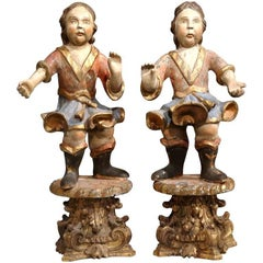 Pair of 18th Century Italian Carved Polychrome Cherub Sculptures on Gilt Stands
