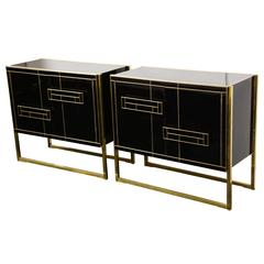 One of a Kind Signed Pair of Black Glass and Brass Cabinets