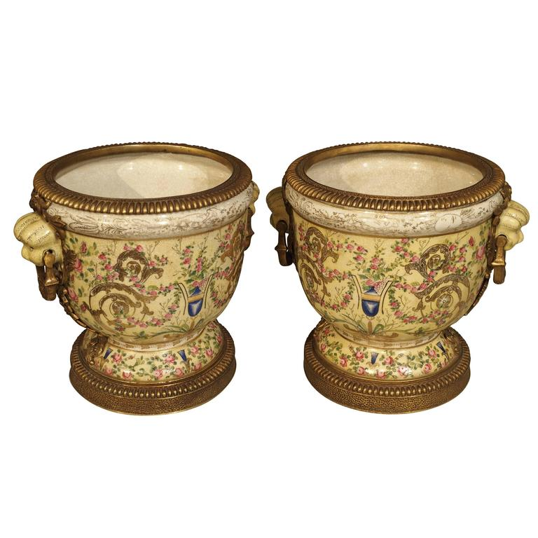 Pair of Painted Porcelain Urns with Gilt Mounts, 20th Century