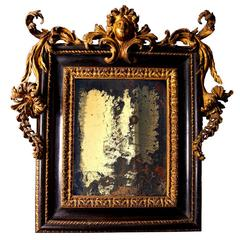 Baroque Italian carved giltwood and ebonised mirror Roman, late 17th century
