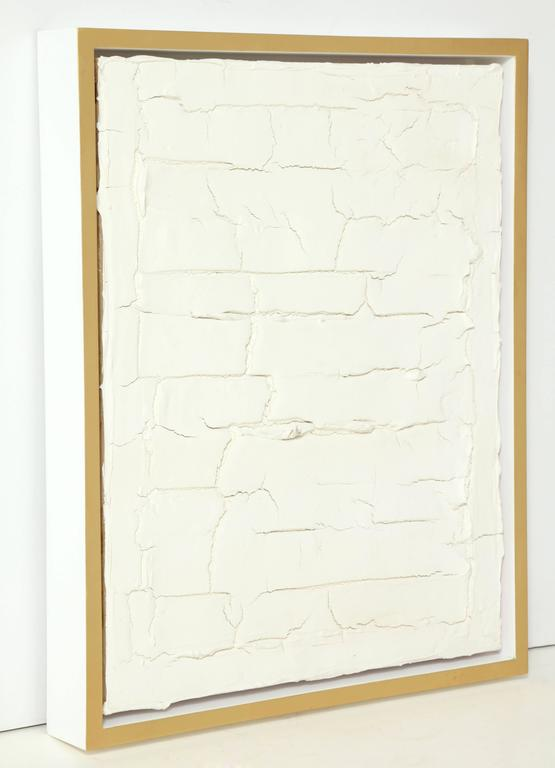 """Contemporary artist Peter Buchman's """"Untitled No. 3, Plaster Series"""" is made of joint compound, plaster, paint on wood and a white edge/gold leaf frame. This piece is an attempt at controlling the uncontrollable. Or is the artist being"""