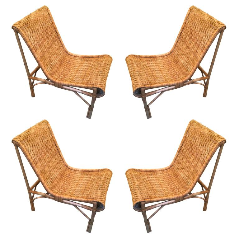 Louis Sognot Exceptional Set of Four fy Rattan Lounge Chair For Sale at 1s