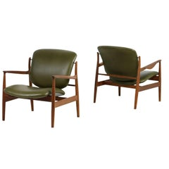Amazing Pair of 1950s Finn Juhl Lounge Easy Chairs Mod. FD 136 Teak and Leather