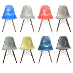 Eight Multicolored Herman Miller Eames Dining Chairs