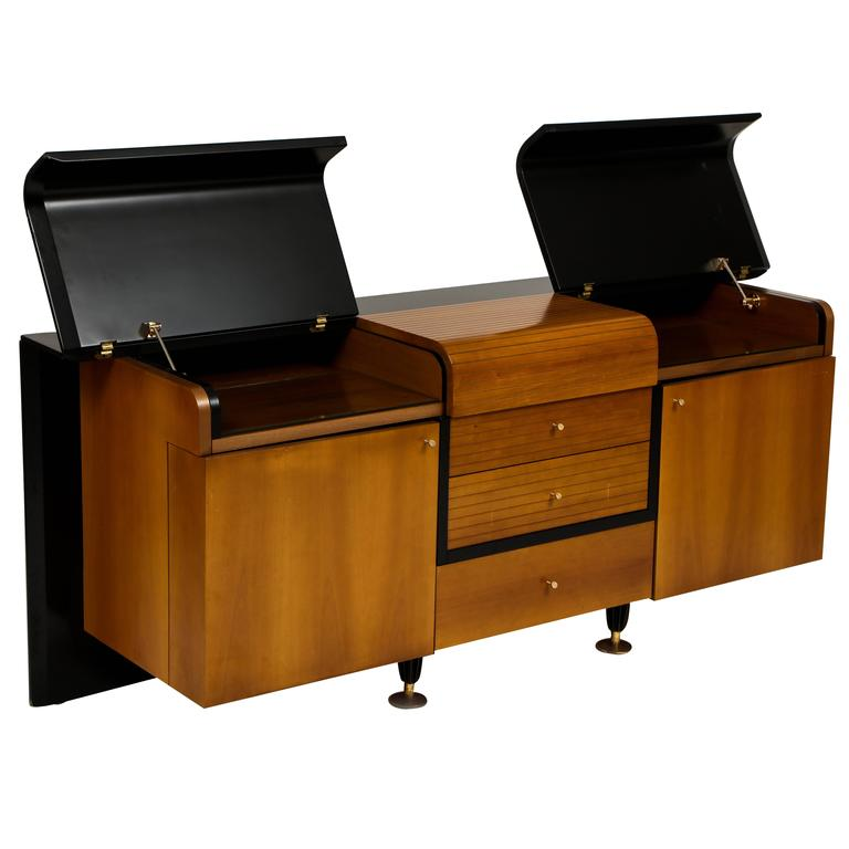 PierreCardin sideboard buffet black and wood, 1980s, 1990s.  This rare sideboard is in excellent vintage condition with two top sides that come up and plenty of storage. It is made of laminate and wood with Brass Details throughout. There is a