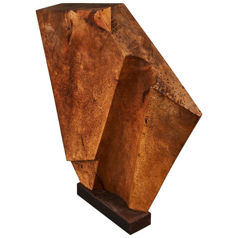 Striking Wood Sculpture Mounted on a Metal Base