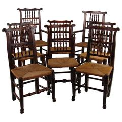 Set of Eight English Elm Provincial Spindle Back Chairs with Rush Seats