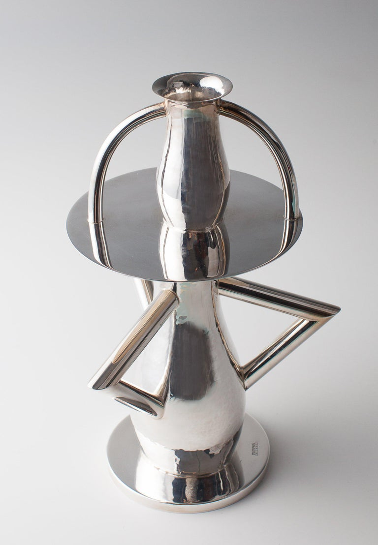 The Alaska is a flower vase in silver brass. It is one of the first designs produced by Sottsass for Memphis in 1982. Measures: H. 30 cm. Executed by Rossi e Arcandi, Monticello Conte Otto, Vicenza for Memphis, Milan. Brass, asymmetric several