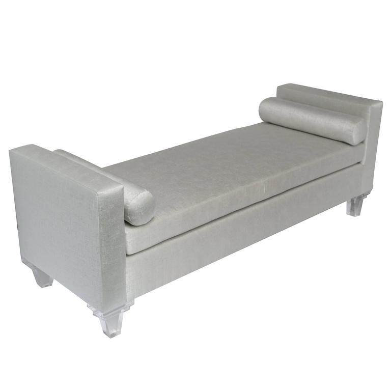 Hollywood regency mid-century modern style daybed and chaise lounge. Elegant silver mist upholstery has woven fibers with hints of platinum silver and very mild hints of sea mist green. The streamline daybed features two bolster pillows and has