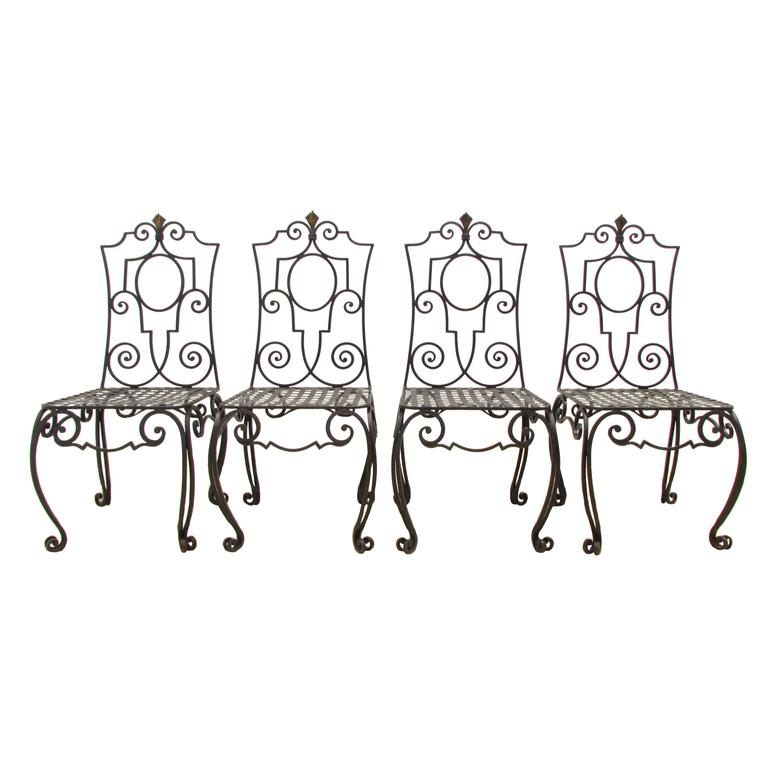 Set of Four Jean-Charles Moreux Style Wrought Iron Chairs