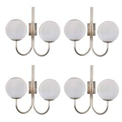Four Opaline Glass Wall Lights