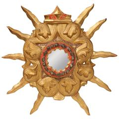 Early 20th Century French Carved Gilt Wood and Polychrome Sunburst Mirror