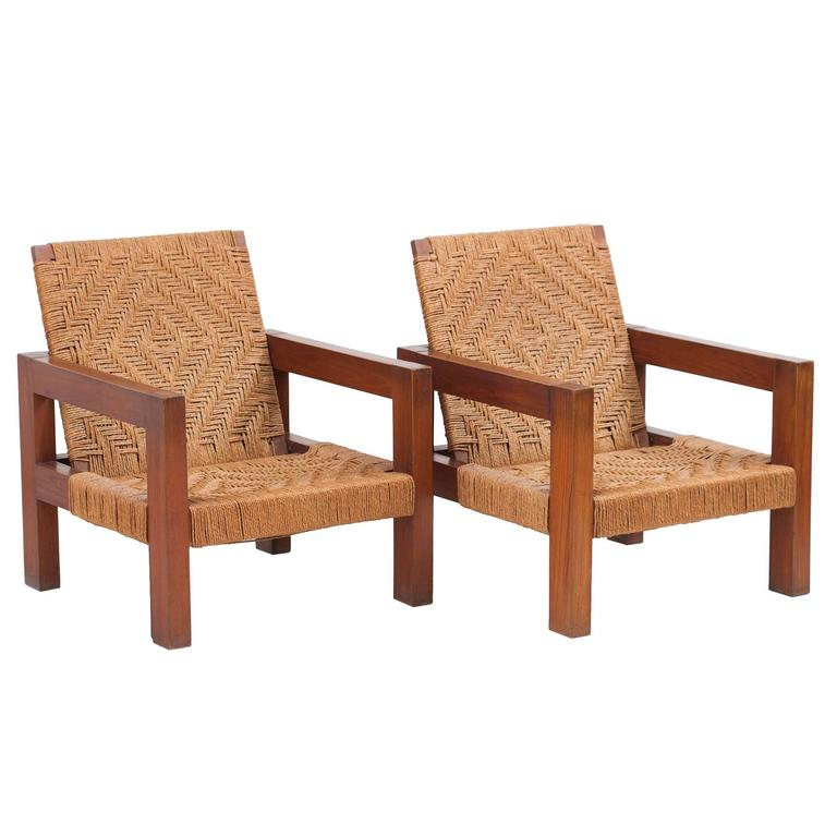 Pair Of Indian Modernist Teak And Jute Lounge Chairs For Sale