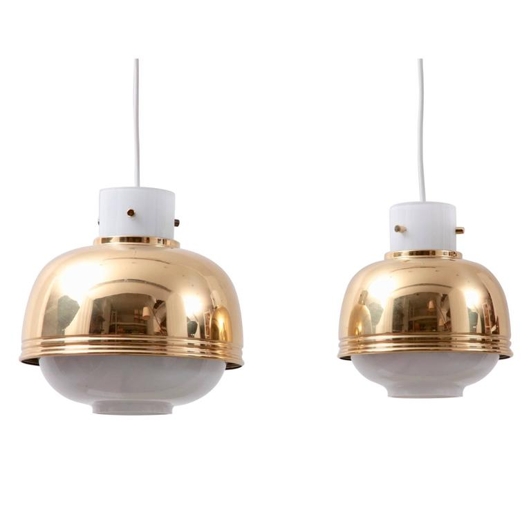 Pair of Brass and Glass Pendant Lamp by Glashütte Limburg